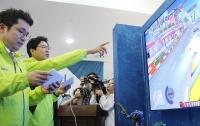 [최승진의 게임카페] 국회서 게임 즐긴 김상민-김광진 의원 '박수'