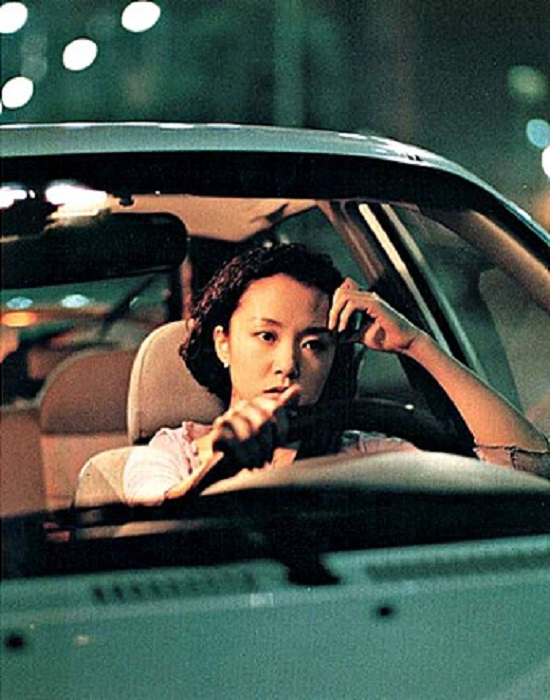 영화 접속에서 수현을 연기한 배우 전도연. 배우 전도연은 1997년 영화 접속으로 멜로의 여왕이라는 별명을 얻었다. /접속 포스터