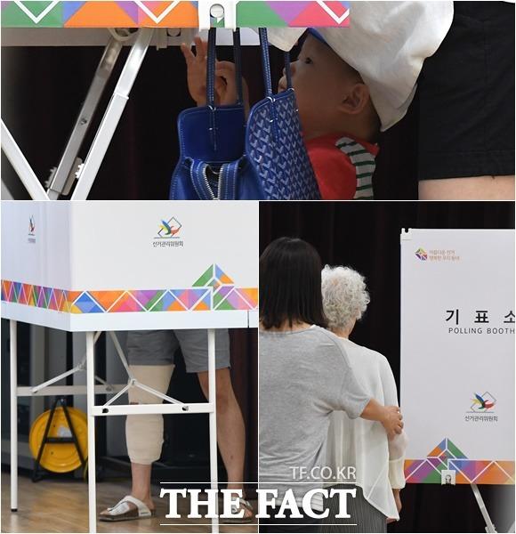 6·13 지방선거 사전투표일인 8일 서울 강남구 압구정동 주민센터에 마련된 사전투표소에서 엄마를 따라 온 어린 아이부터 노인, 부상자 (위부터 시계방향) 등 다양한 시민들이 투표를 하고 있다. /이새롬 기자
