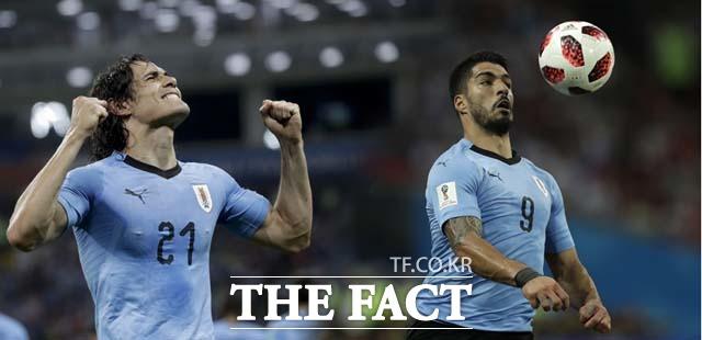 우루과이, 포르투갈 제압! 수아레스(오른쪽)·카바니 콤비가 우루과이-포르투갈 경기에서 맹활약을 펼치며 우루과이의 승리를 이끌었다. /소치(러시아)=AP.뉴시스