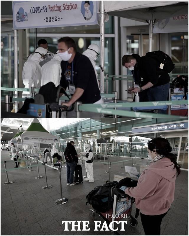 철저한 방역 3월 27일 유럽발 입국 외국인들이 공항 야외 공간에 마련된 개방형 선별진료소를 통과하고 있다.