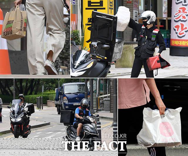 수도권을 중심으로 사회적 거리두기 2.5단계가 시행 중인 가운데 11일 오후 경기도 과천 시내의 한 거리에서 직장인들이 포장음식을 들고 이동하고 있다. /과천=이선화 기자